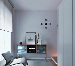 Laikrodis lipdomas ant sienos